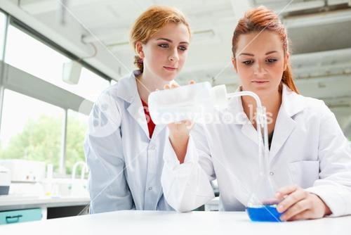 Scientists doing an experiment