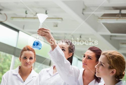 Science students looking at a flask