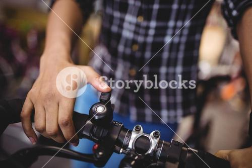 Mechanic ringing a bicycle bell