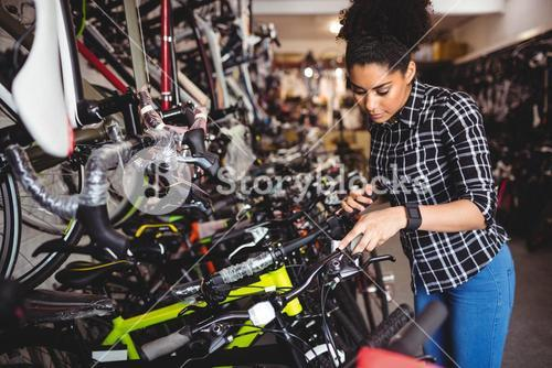 Mechanic examining bicycles