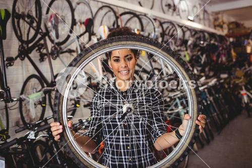 Mechanic holding a bicycle wheel