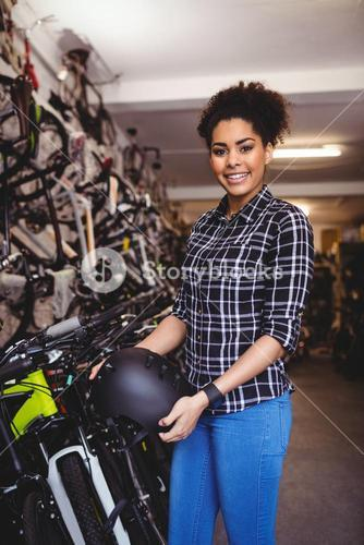 Mechanic holding a bicycle helmet