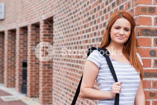 Smiling student standing up