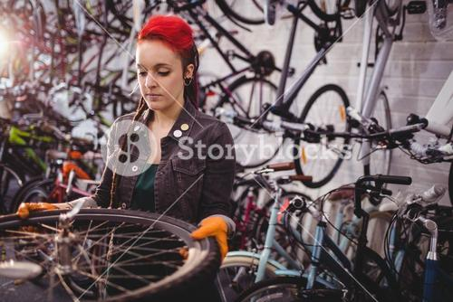 Mechanic examining a bicycle wheel
