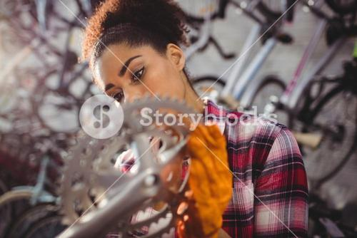 Mechanic examining a bicycle gear