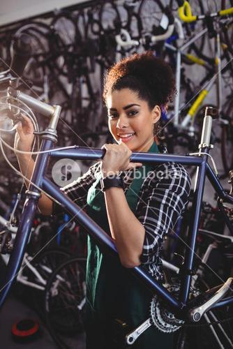 Mechanic holding a bicycle