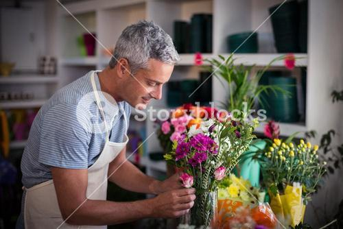 Florist preparing a flower bouquet