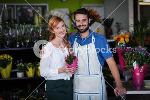 Couple standing with flower bouquet