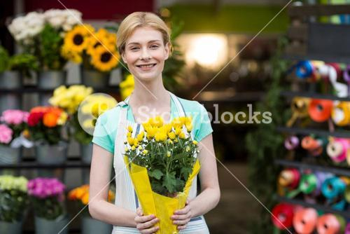 Female florist holding bouquet of flower