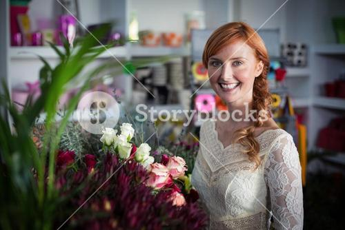 Female florist standing and smiling