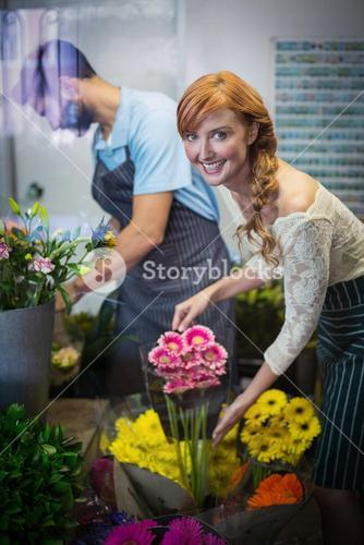 Couple arranging flower bouquet