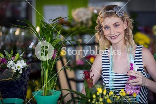 Female florist holding spray bottle