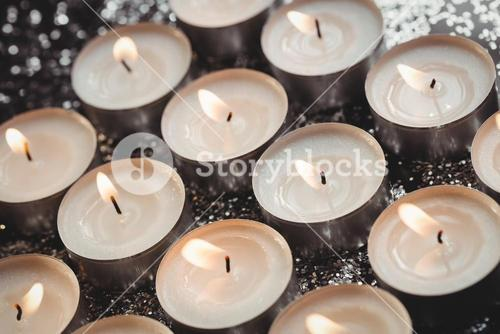 Close-up of candles burning