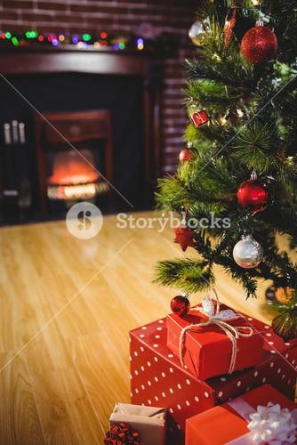Wrapped gifts near a christmas tree