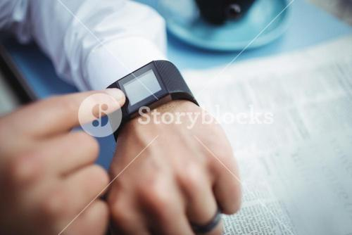 Man adjusting time on smartwatch