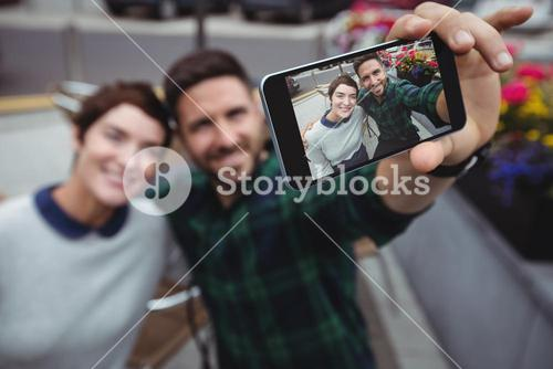 Couple taking selfie on mobile phone