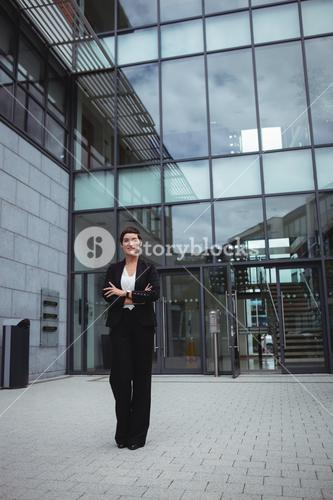 Smiling businesswoman standing in office premises