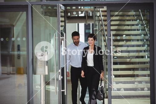 Businesspeople leaving office