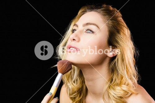 Beautiful woman posing with make-up brush