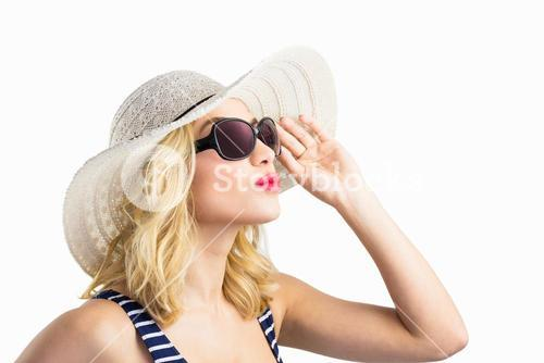 Beautiful woman posing with sunglasses against white background