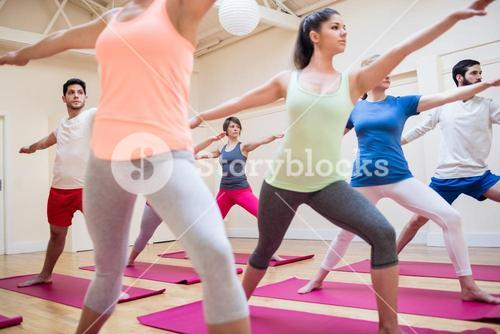 Group of people performing stretching exercise