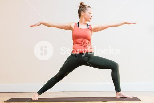 Woman performing warrior pose