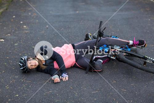 Female biker fallen from her mountain bike