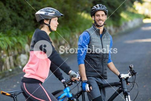 Biker couple with mountain bike on the road