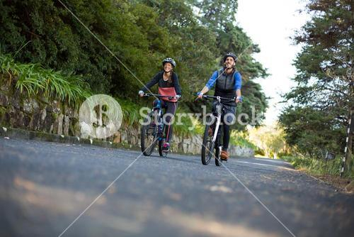 Biker couple cycling on the countryside road