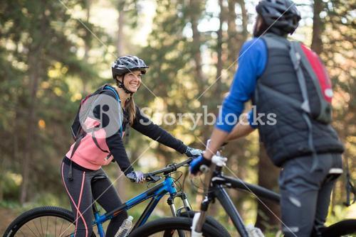 Biker couple smiling and interacting with each other