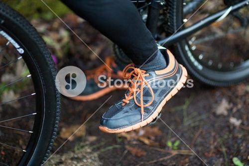 Low section of male biker with mountain bike
