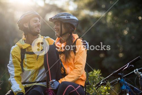 Biker couple sitting and interacting with each other