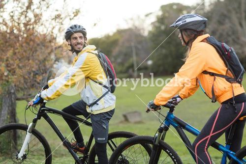 Biker couple interacting while cycling