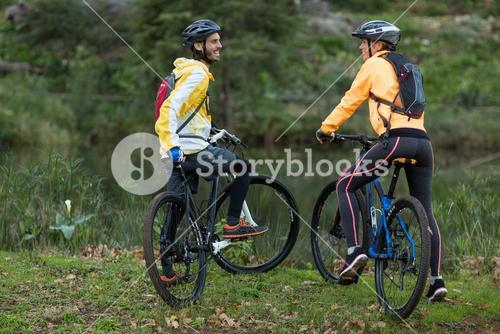 Biker couple interacting with each other with mountain bike