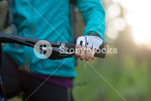 Mid-section of female biker with mountain bike