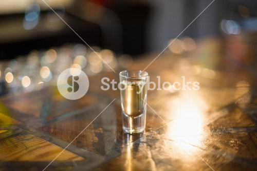 Tequila shot glass on counter