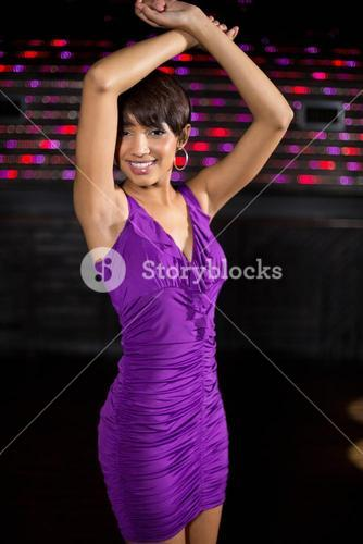 Young woman dancing on dance floor