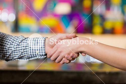 Couple holding hands in bar