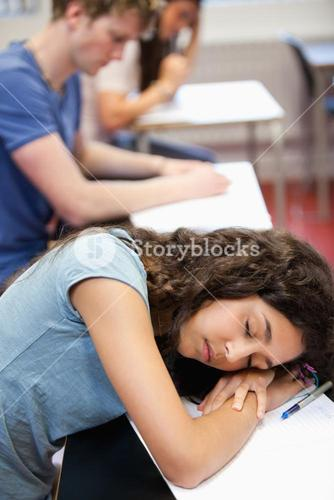 Portrait of a student sleeping on her desk