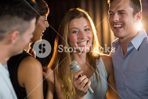 Happy friends singing song together