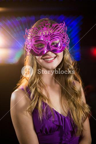 Woman wearing masquerade in bar