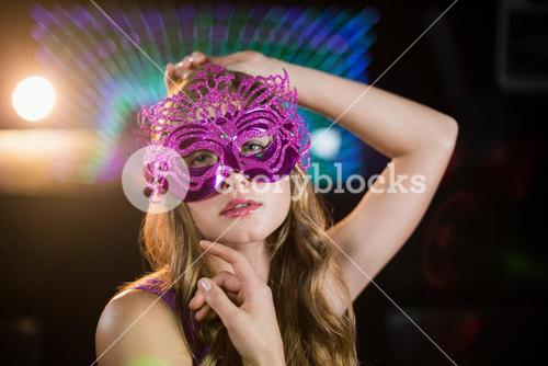 Woman posing with masquerade in bar