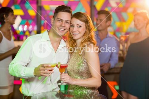 Romantic couple having glass of cocktail