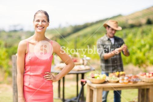 Portrait of female customer standing in front of stall