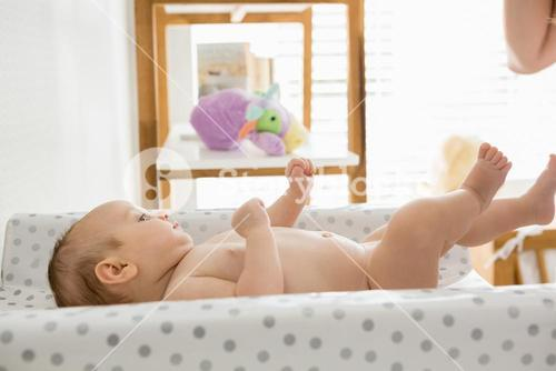 Baby lying on baby bed