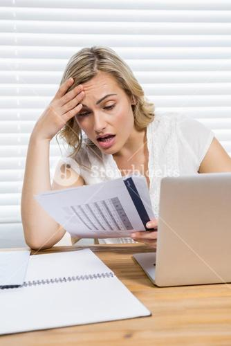 Stressed woman reading document