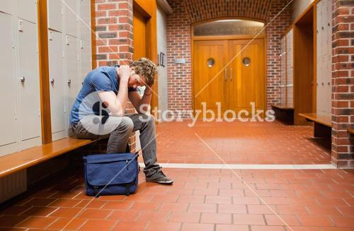 Sad student sitting on a bench