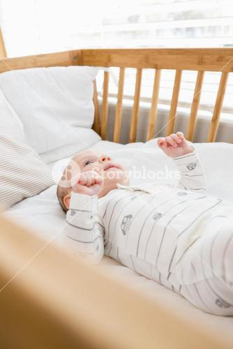 Baby boy relaxing on a cradle