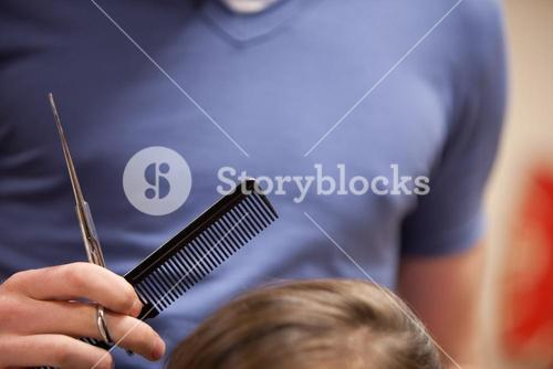 Close up of scissors and a comb