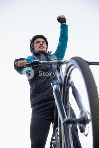 Excited mountain biker in forest